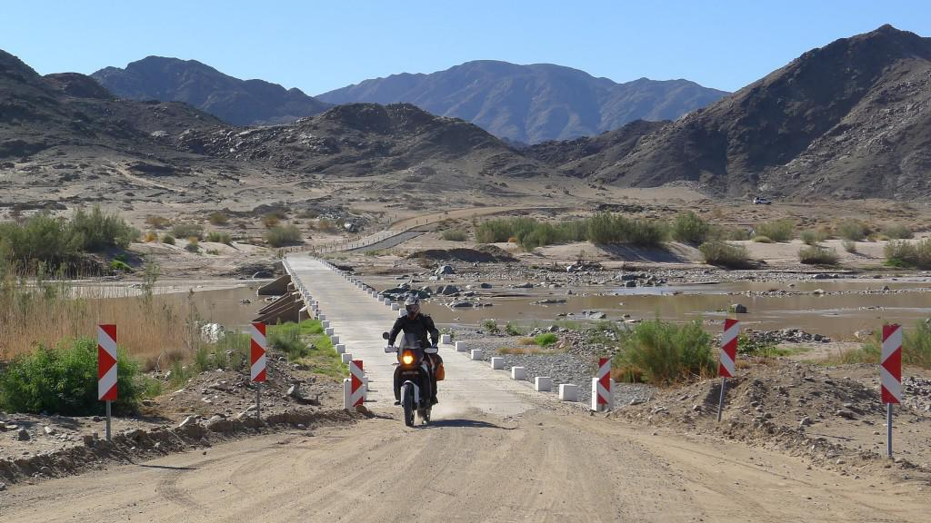 A motorbike crossing the Fish River in the Ai-Ais National Park. The roads of the park are ideal for mountain biking.