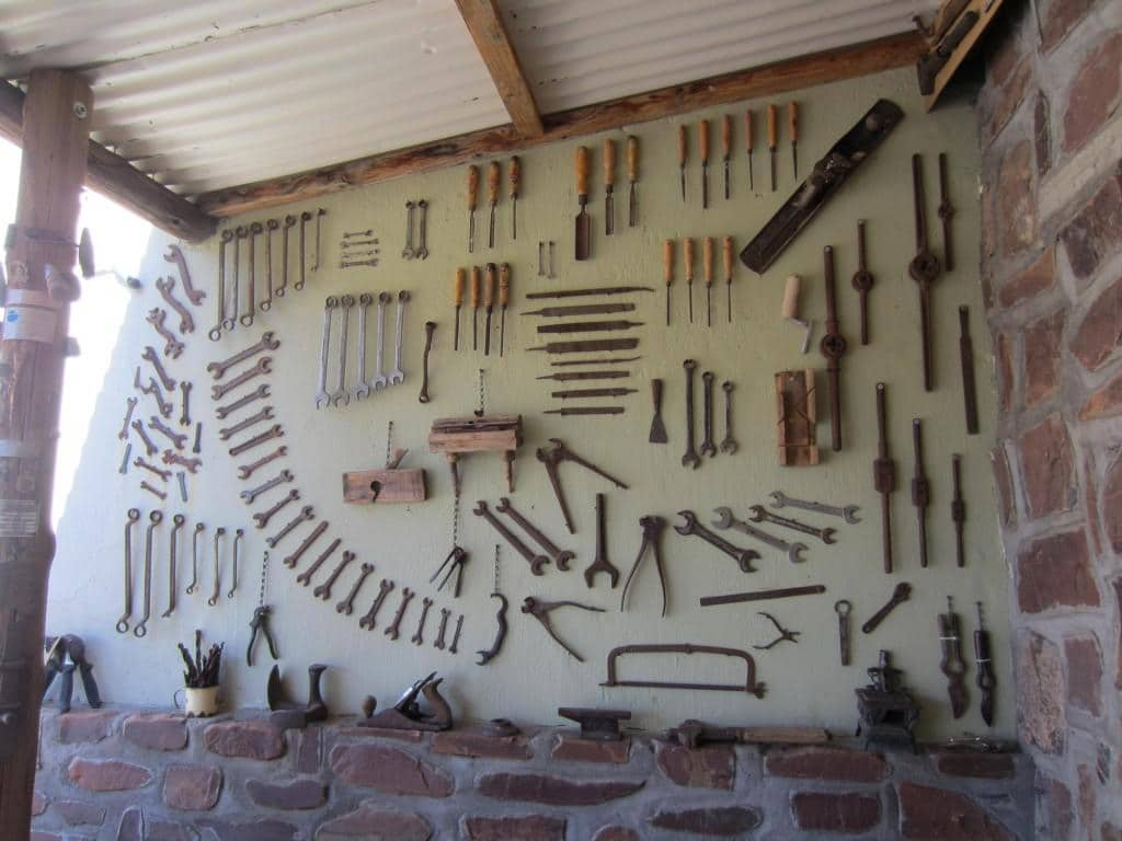 One of the walls is decorated with old tools.