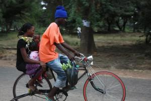 Bicycle taxis often transport  more than one passenger at a time.