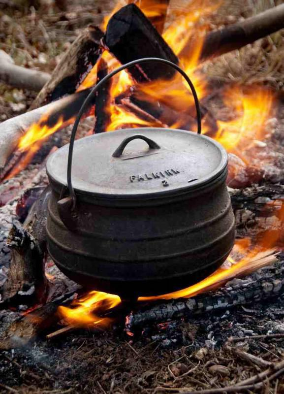 The traditional way of cooking Potjiekos is in a three-legged cast iron pot.