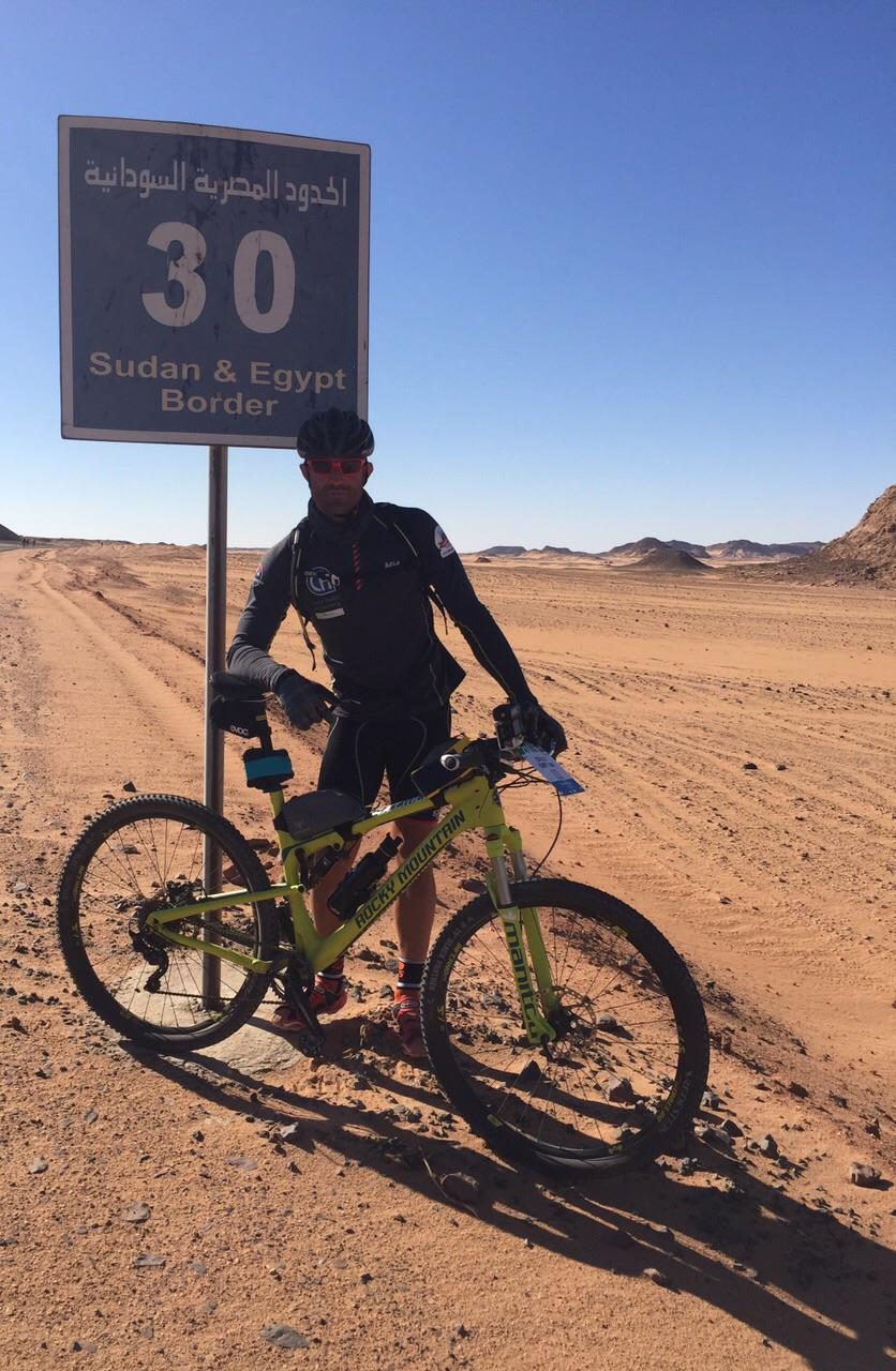 Ivan Zimmerman with his bike near the border between Egypt and Sudan.