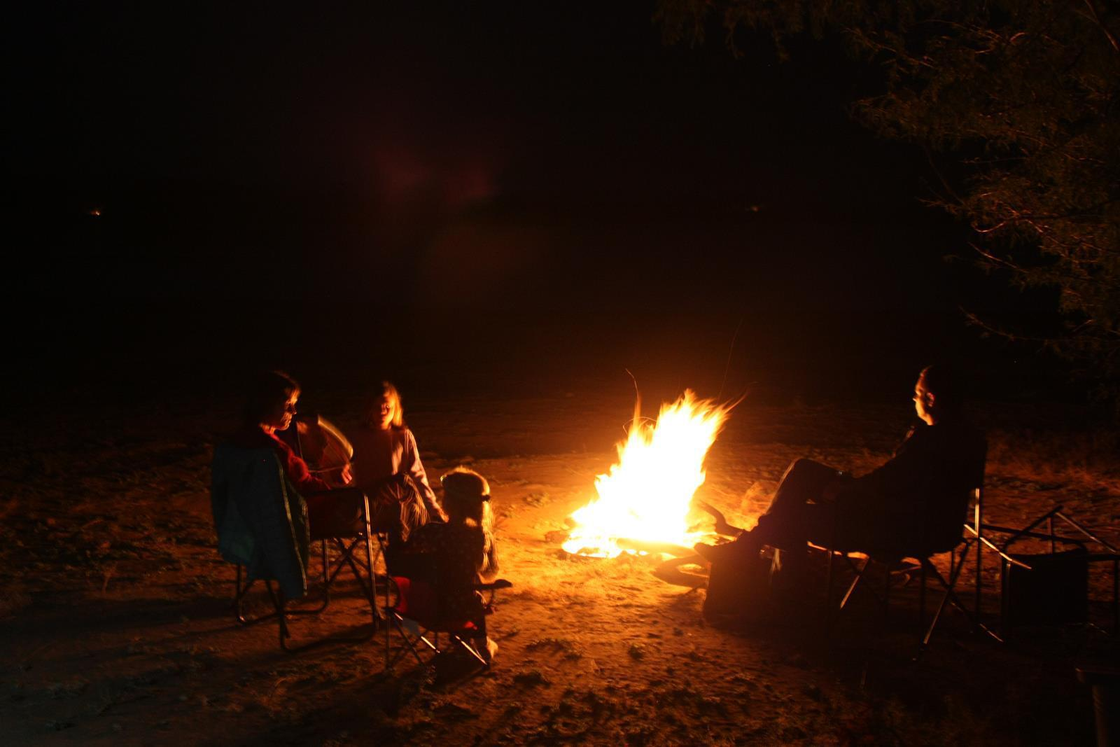 Sitting around the fire in the Vwasa Reserve in Malawi. (Photo: Karin Theron)