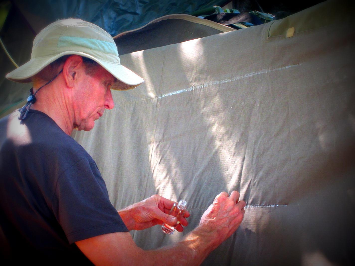 Pete waterproofing the awning.