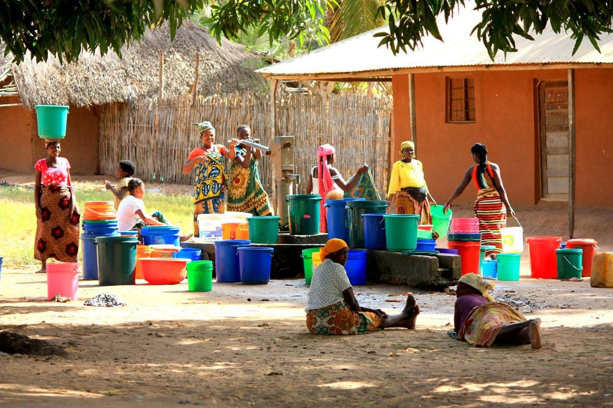 Women fetching water from the communal borehole.