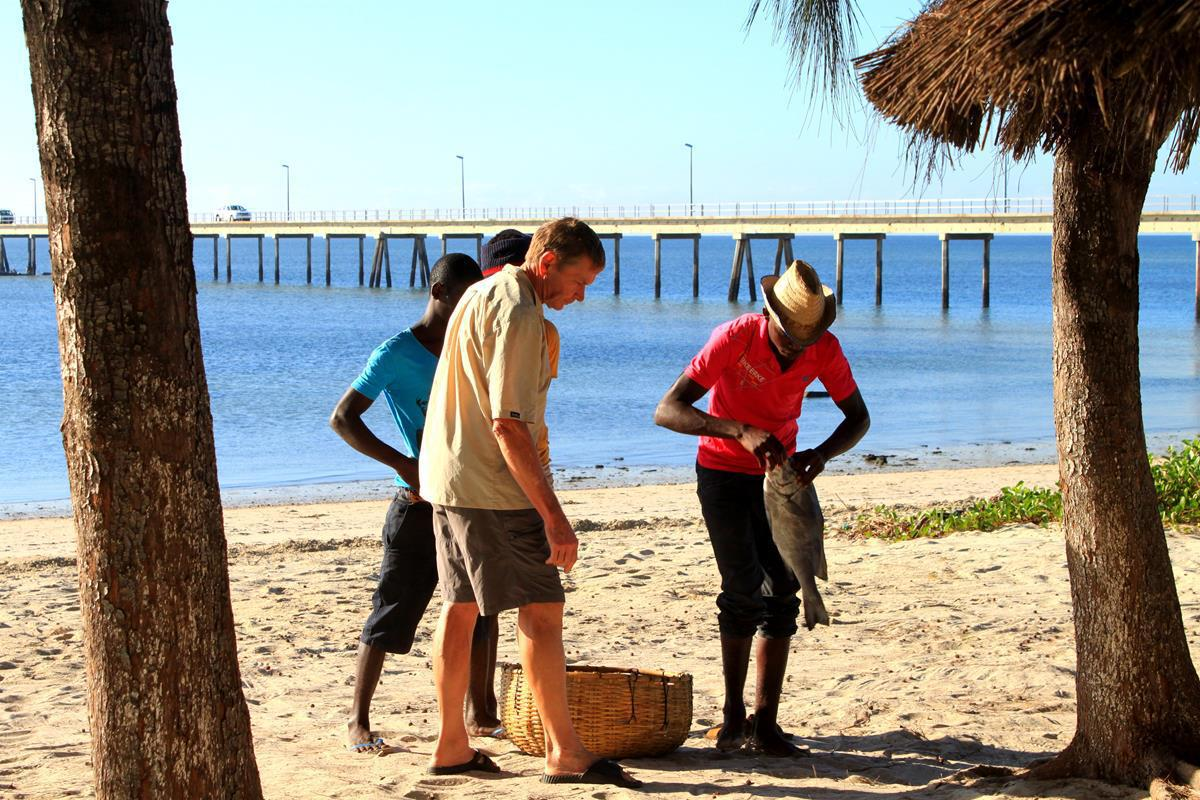 Buying fish from the local fishermen at Casuarina.