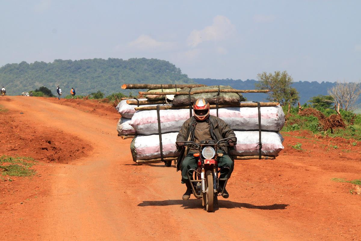 Transporting heavy loads like bags of charcoal by motorbike is a familiar sight in Kenya.