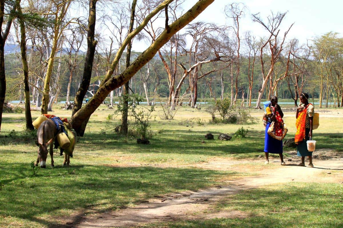 Women walking past while we were having coffee at Lake Elmenteita.
