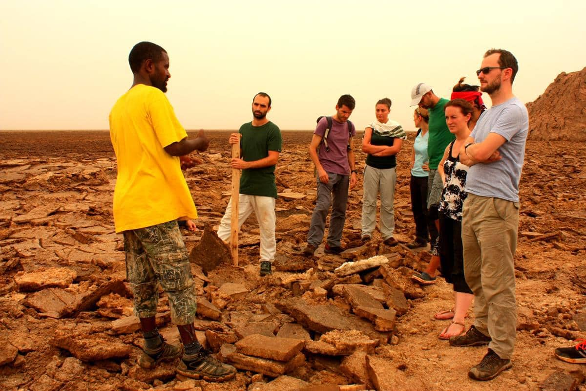Our guide explains how salt is mined in the Danakil.
