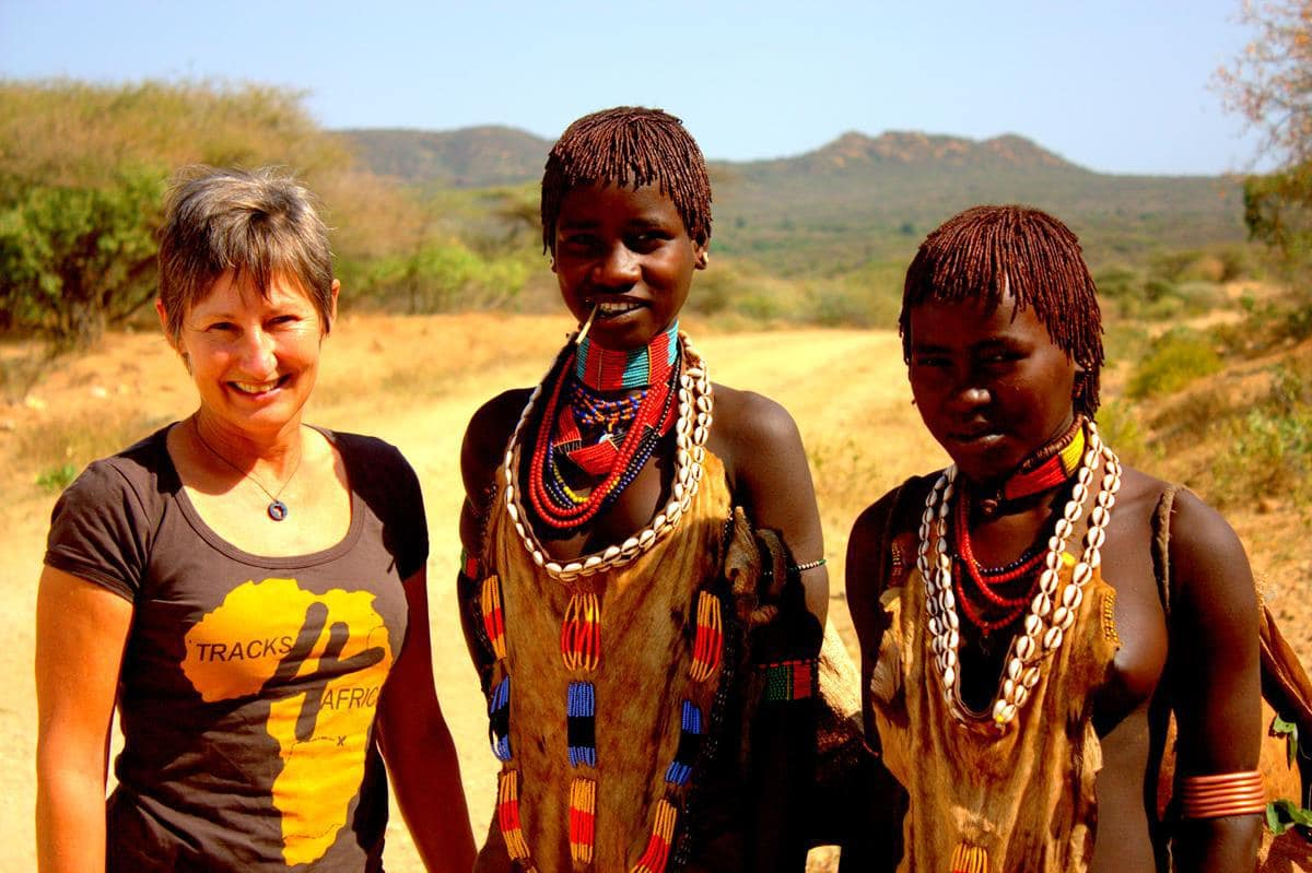 Me with two herder girls from the Hamer tribe near Turmi.