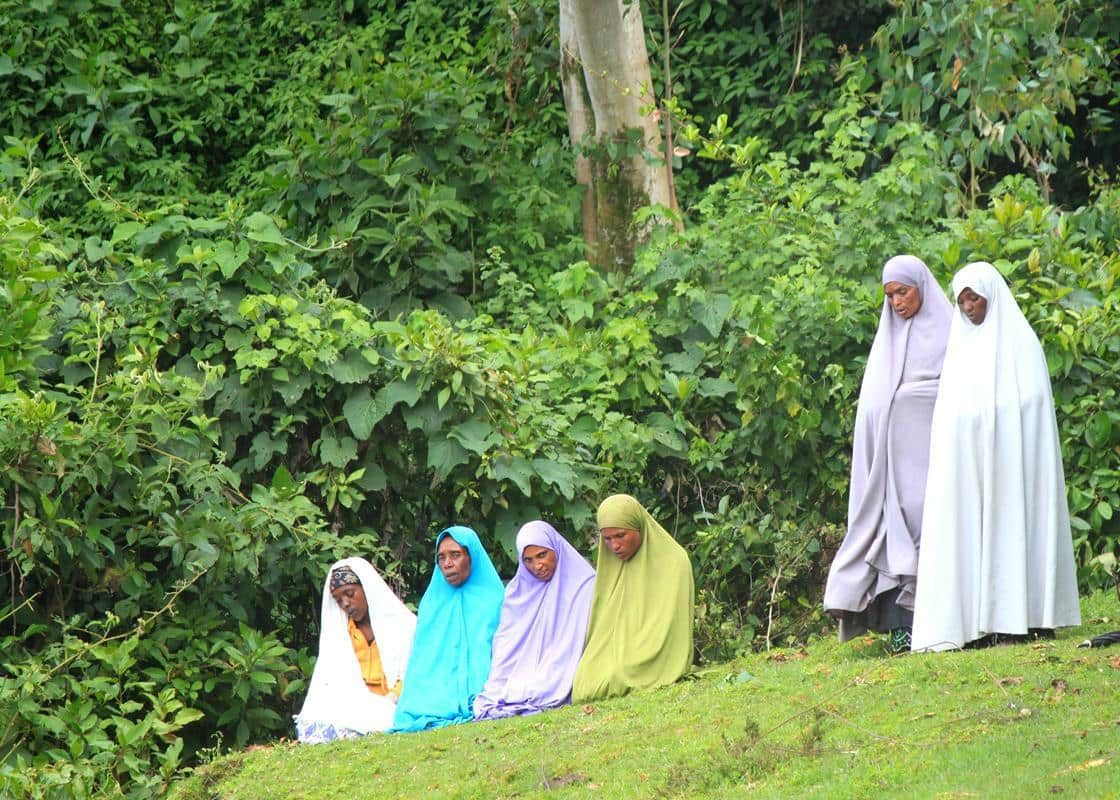 Muslim women praying next to the road.