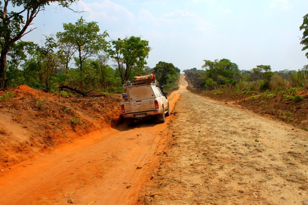 Vehicles made new tracks next to the rocky road.