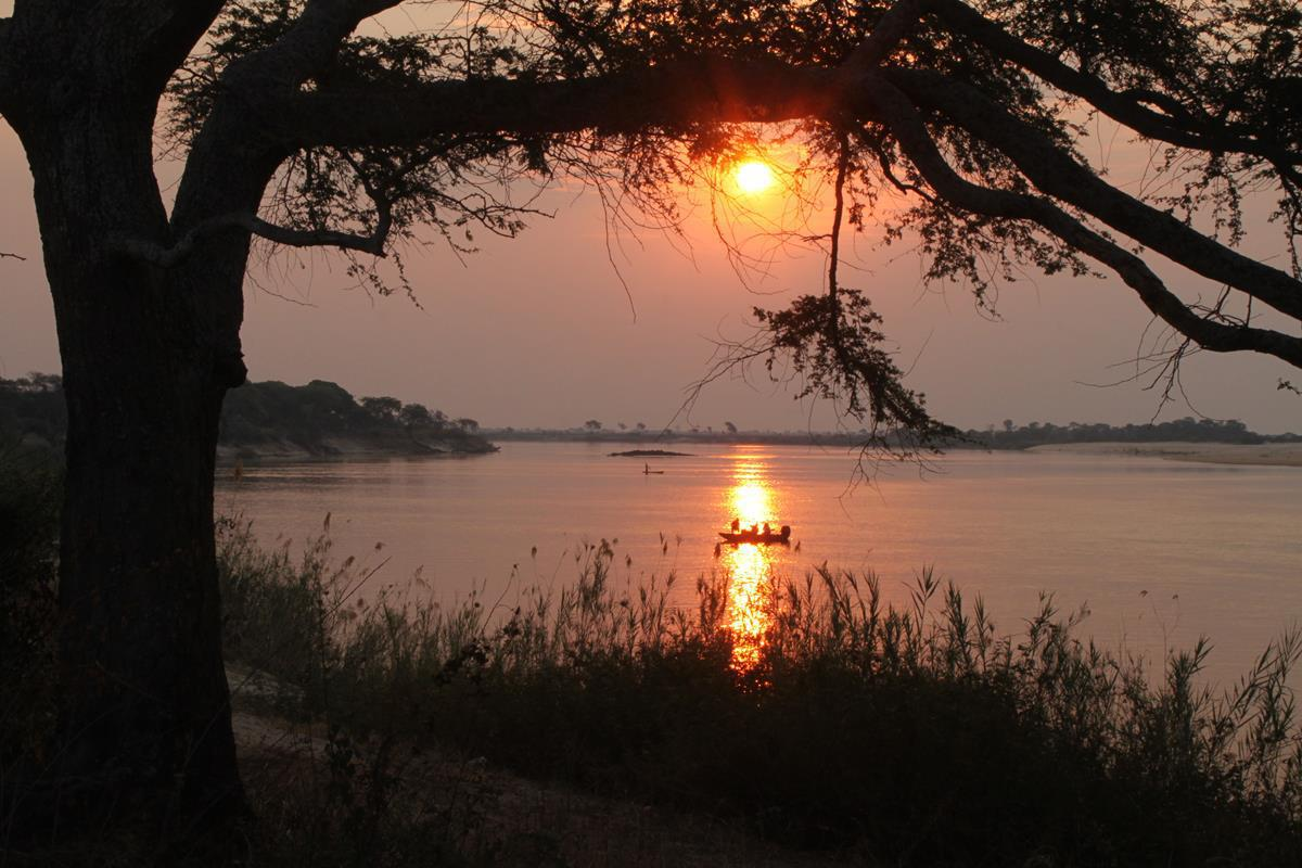 Sunset over the Zambezi at Ngulwana village camp.