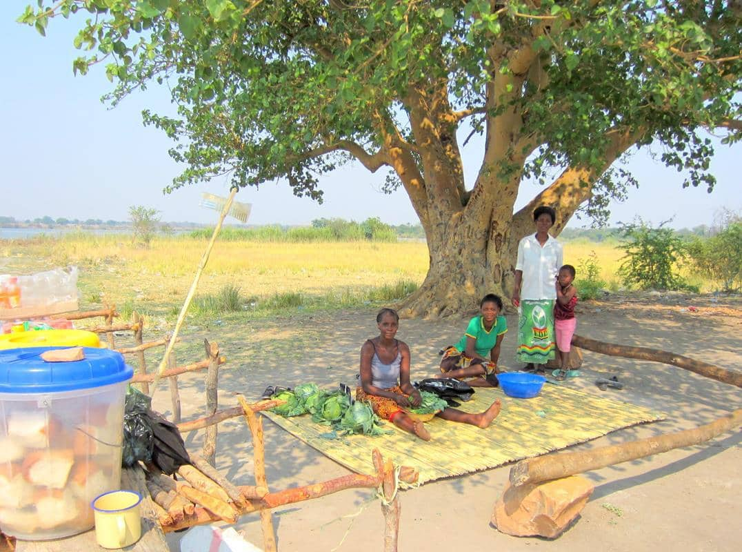Women selling their produce at the Sikuka pontoon crossing near Sioma.