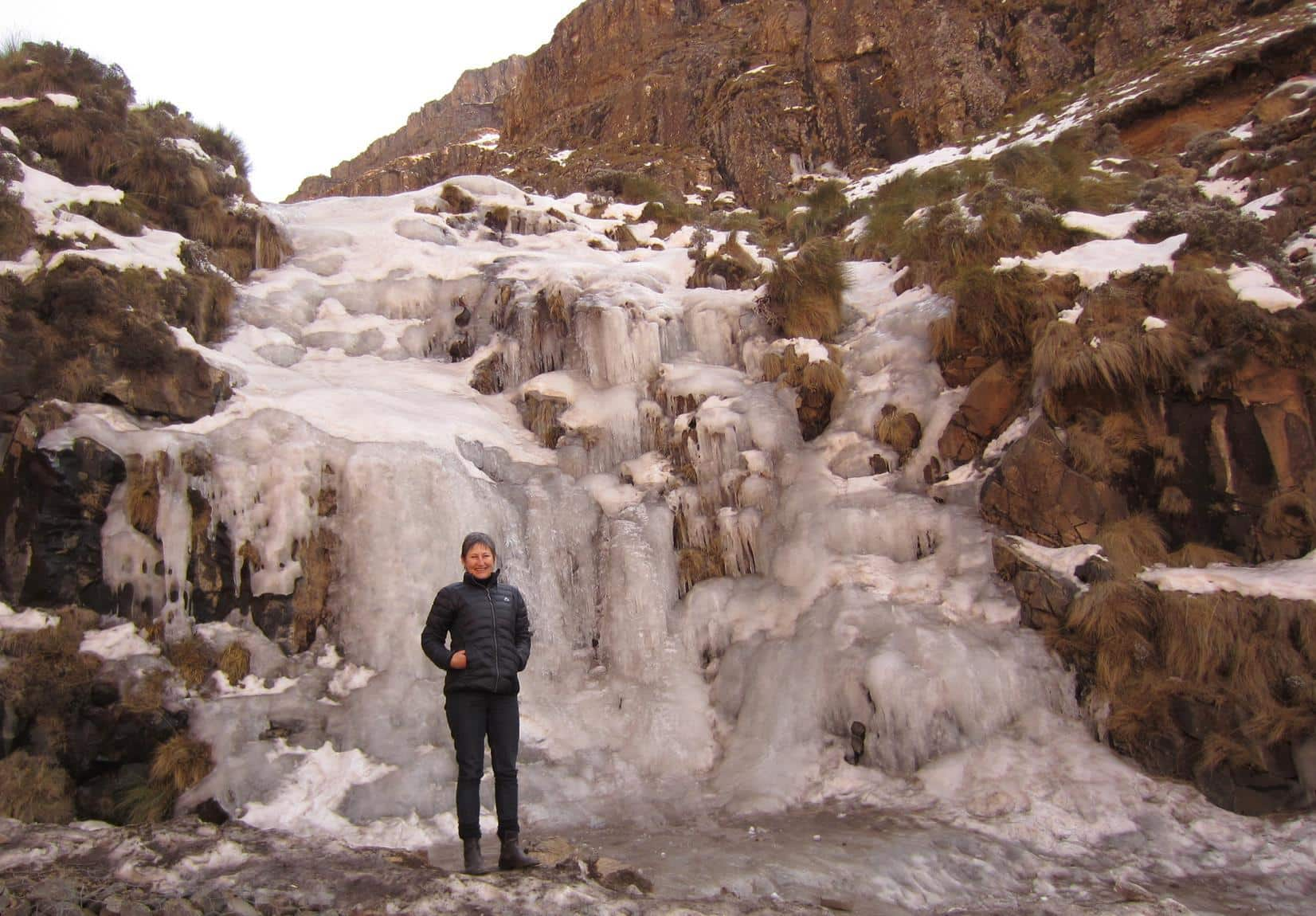 Me in front of a frozen waterfall.