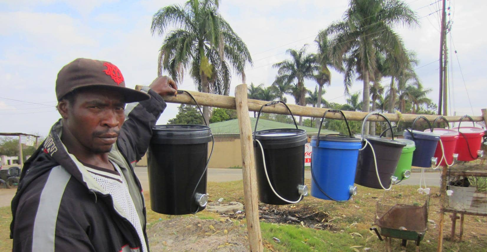An entrepreneur selling plastic buckets with electric elements.