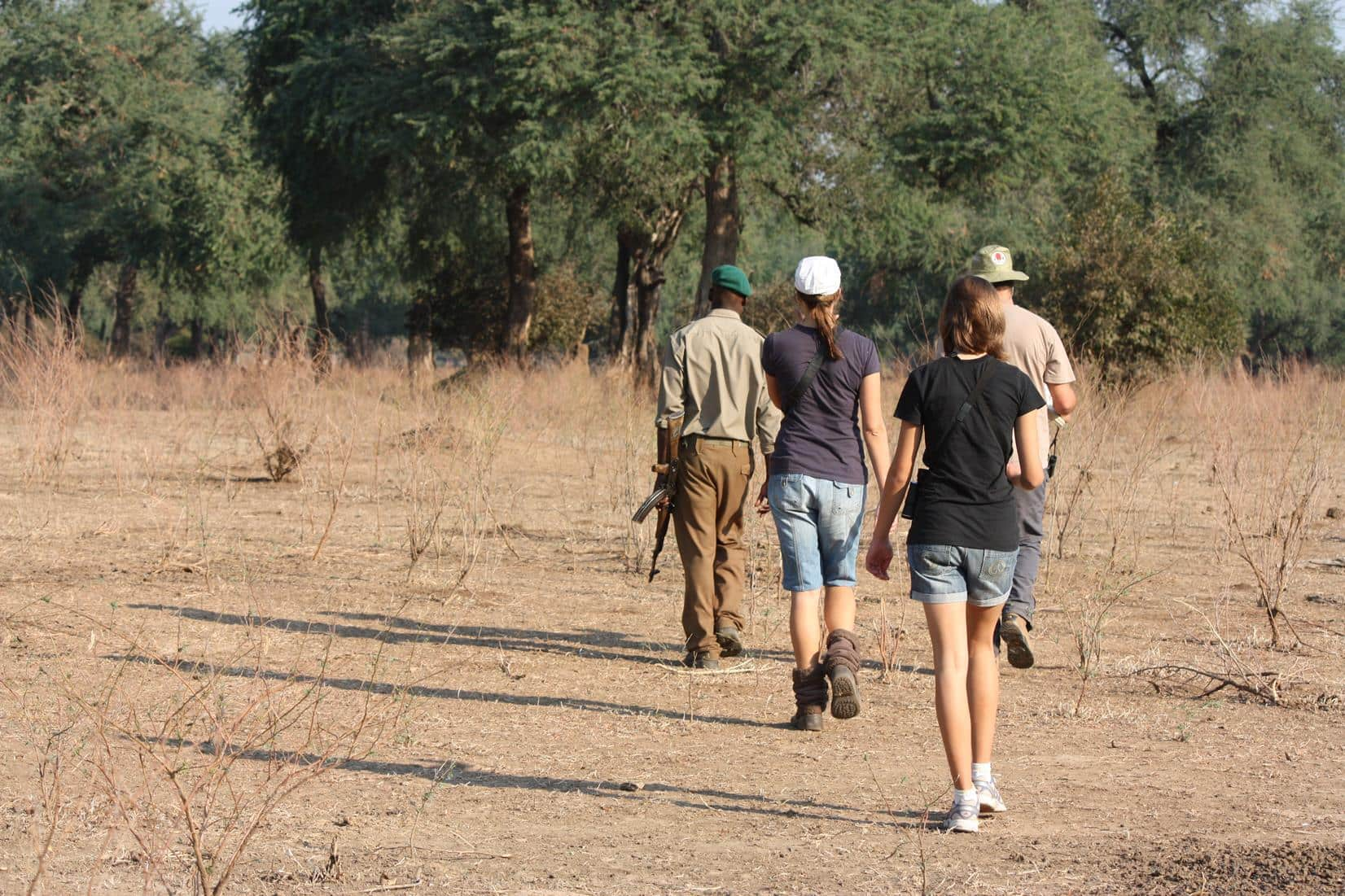 It is best to wear long-sleeved shirts, long pants, boots and a hat when you walk in the veld.