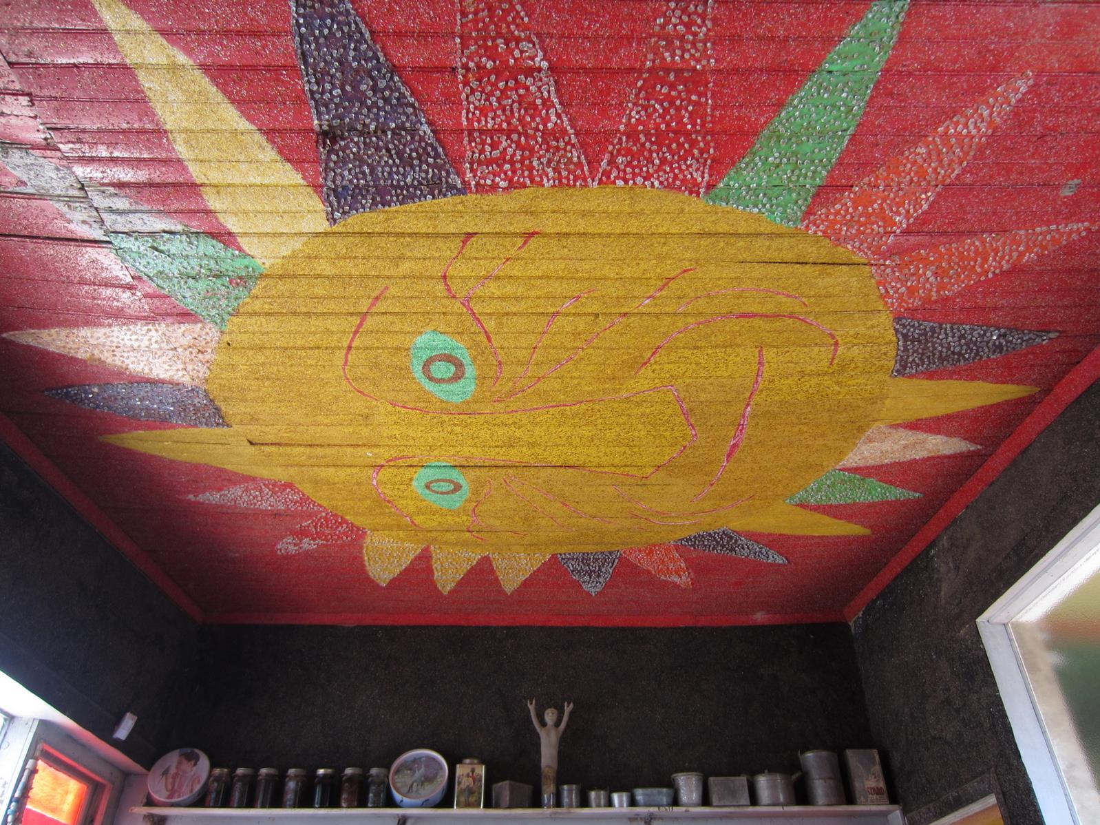 The ceiling of the pantry was brightly painted with a sun face.