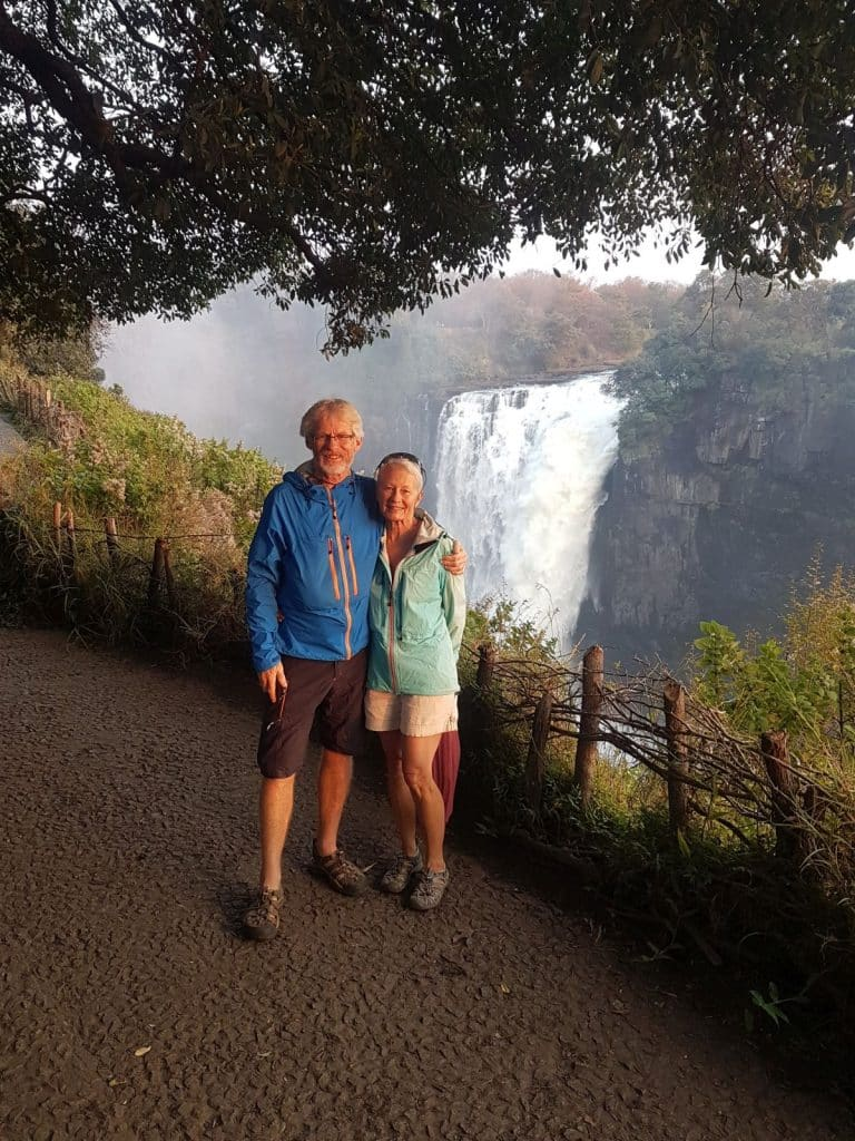Peter and Colleen McNulty in front of the waterfalls