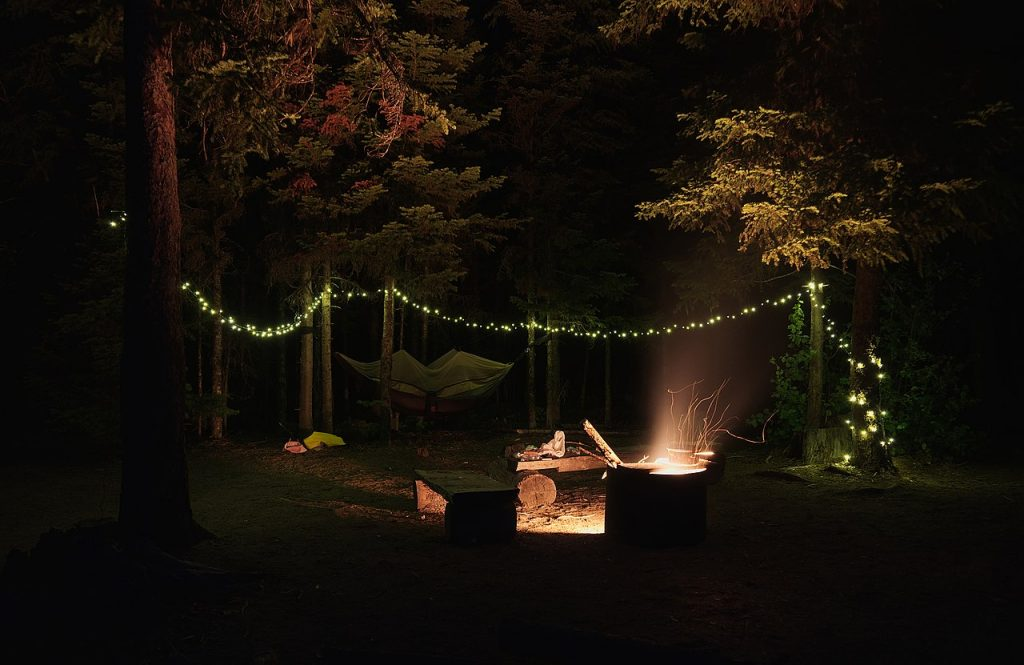 A campsite illuminated by fairy lights