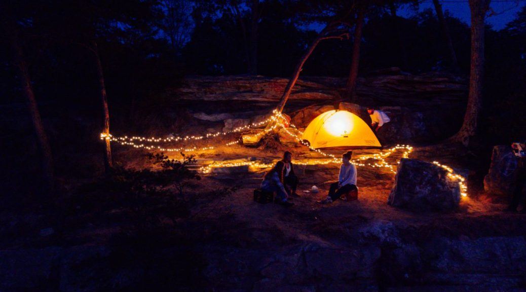 a camping ground lit up at night